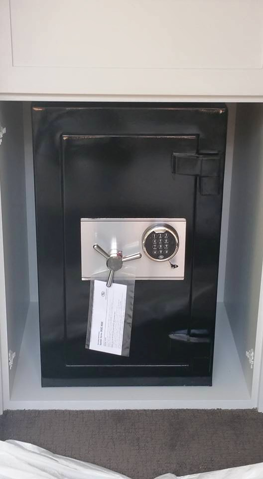 Installing A New Safe Into A Cabinet In A Home