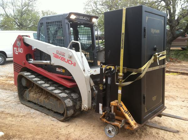 Here we are moving a heavy Mustang gun safe on a ranch with a skidloader