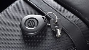 Harley Davidson replacement motorcycle key sitting on the seat of the bike